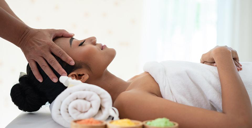 Woman enjoying a massage and spa treatment