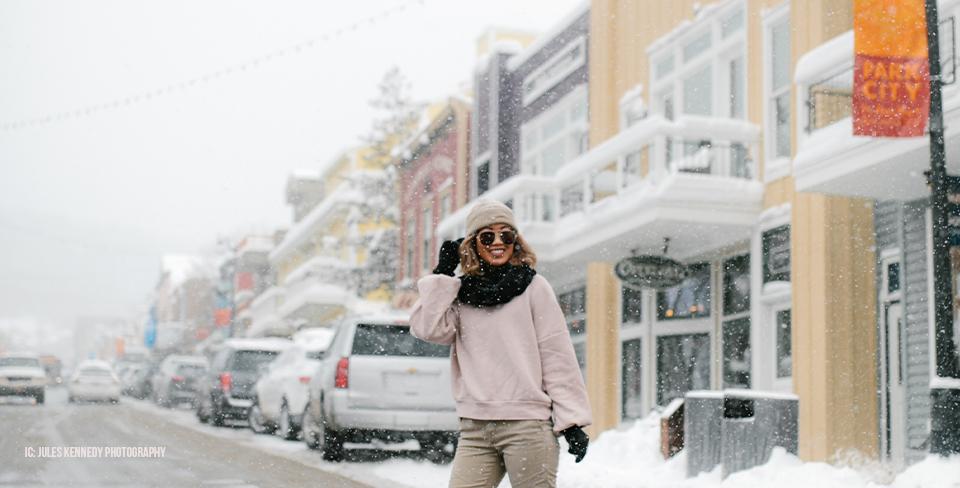Woman walking across the street in Park City winter
