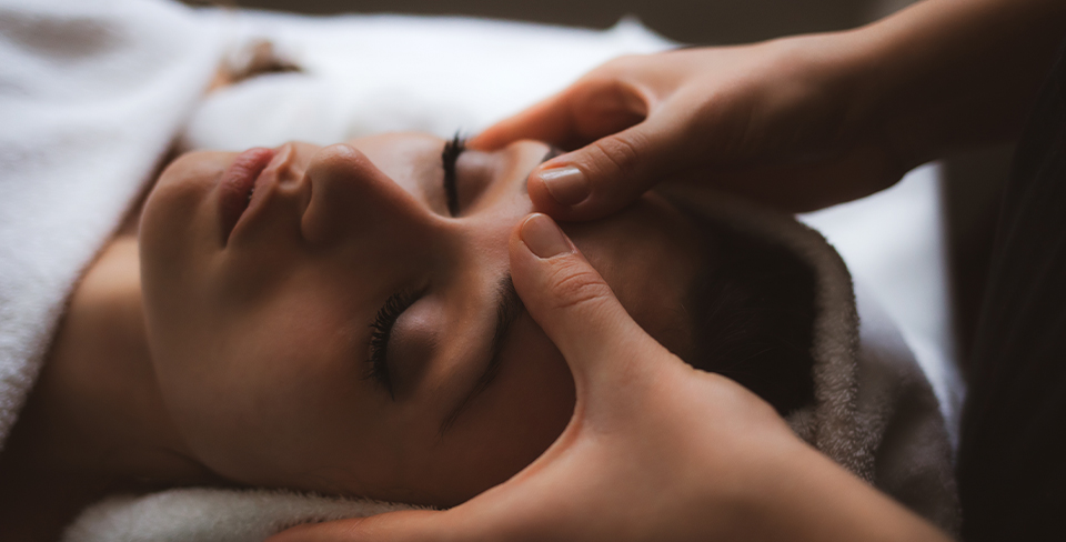 Woman getting a massage 2020 travel goals